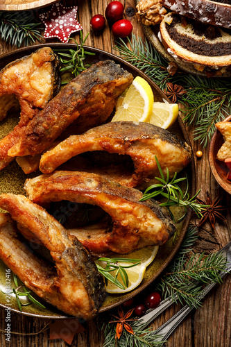 Christmas carp, Fried carp fish slices on a ceramic plate, close up, top view. Traditional christmas eve dish. Polish Christmas