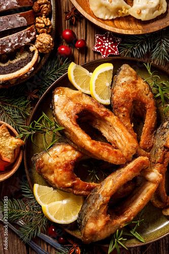 Christmas carp, Fried carp fish slices on a ceramic plate, close up Canvas Print