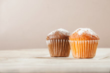 Lemon And Chocolate Muffins On A Wooden Table. Space For Text.