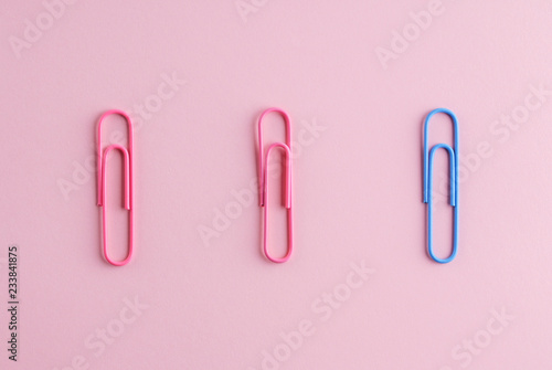 Fotografie, Obraz  Colored paper clips on a pink background.