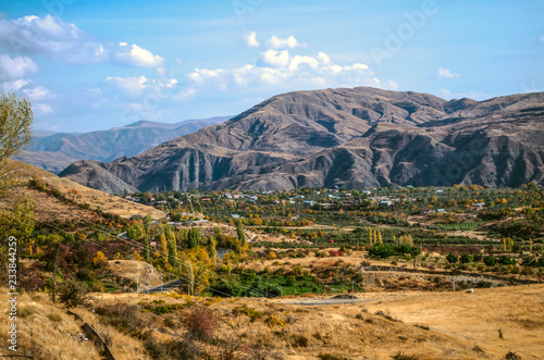 Autumn landscape with yellowed fields and gardens in the Armenian village,located high in the mountains Geghama ridge