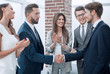 business team applauds its leaders