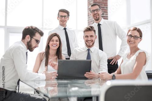 Fototapeta successful business team at the Desk in the office. obraz na płótnie