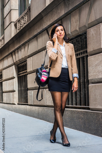 Young American Woman Traveling Working In New York Wearing Beige