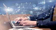 Businessman Typing On Laptop W...