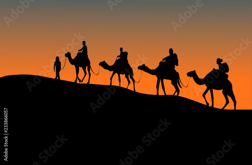 Poster de jardin Desert de sable silhouette of four camel riders. Up hill with sunset background