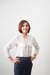 Businesswoman looking at the camera with hands on hips on white background