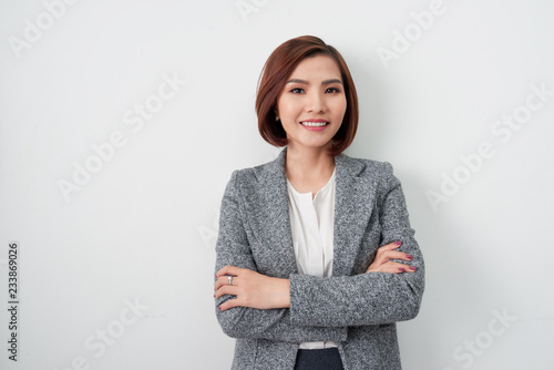 Fotografia  Entrepreneur young asian woman, business woman arms crossed on white background