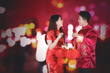 Happy Chinese Couple Carrying Red Lantern