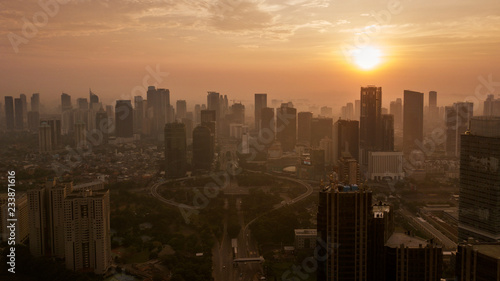 Fototapety, obrazy: Semanggi highway with high buildings at sunset