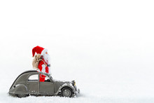 Christmas Celebration, Santa Claus Standing In A French 2cv Vintage Car With Gift Sack, Isolated On White Background