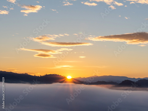 Sunrise with early morning sky scene covered in foggy