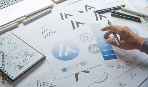 Obraz Graphic designer development process drawing sketch design creative Ideas draft Logo product trademark label brand artwork. Graphic designer studio Concept. - fototapety do salonu