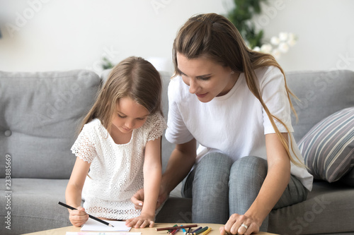 drawing games for little girls Cute Little Girl With Mom Or Baby Sitter Drawing With