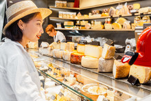 Woman Customer At The Cheese Store At The Organic Market