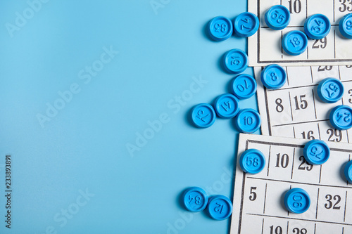 Bingo balls and cards on blue background with copy space. Canvas Print