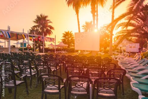 Fotografija  Cinema screen at tropical resort hotel at sunset