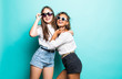 canvas print picture - Friends forever. Two mixed race cute lovely girl friends in sunglasses posing with smile on blue background