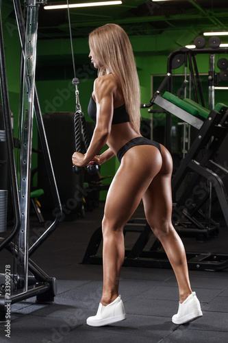 d7b93db10873 Athletic girl working out in gym. Sexy beautiful butt in thong. Fitness  woman doing exercise
