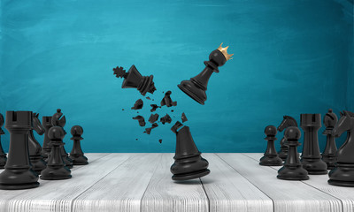 3d rendering of a wooden desk with a small crowned chess pawn hitting a black chess king and destroying it.