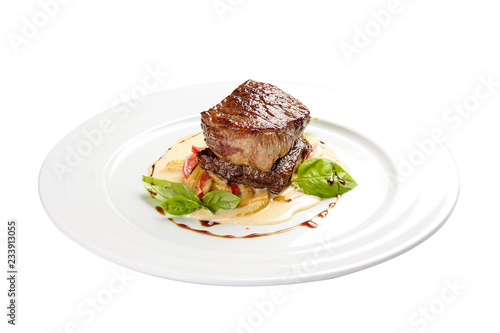 Stampa su Tela Veal medallion with vegetables. On a white background