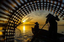 Fishermen In A Boat Catching F...