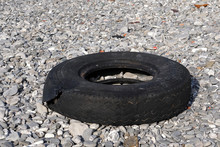 Abandoned Tire On The Beach