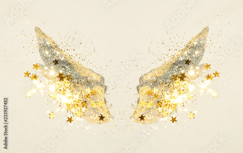 Deurstickers Vlinders in Grunge Glitter and glittering stars on abstract gold and black watercolor wings in vintage nostalgic colors.