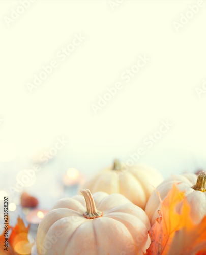 Fototapeta Thanksgiving background. Holiday scene. Wooden table, decorated with pumpkins, autumn leaves and candles. Vertical image obraz na płótnie