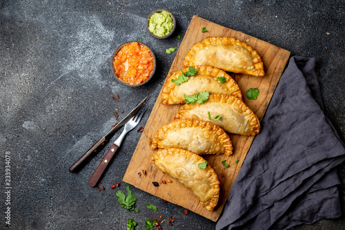 Fotografiet Latin American fried empanadas with tomato and avocado sauces