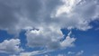 Time lapse of blue sky and white clouds, rolling puffy cloud are moving with white lightnes skies.