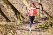 Young Woman Jogging On Trail I...