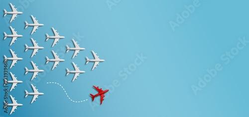 Fotografía  Grupo de aviones en una dirección y un avión rojo apuntando de manera diferente sobre fondo azul