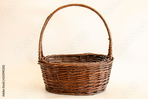 Fotografía  empty wicker basket on soft light background / copy space