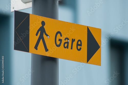 """Fotografía  closeup of train station indication in french """"gare"""" , traduction in english : t"""
