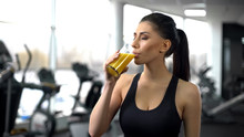 Fit Woman Drinking Refreshing Juice From Glass After Gym Workout, Health Care
