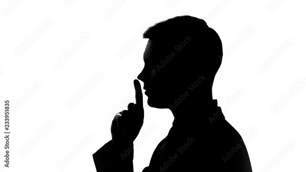 Fototapety, obrazy: Man showing gesture of silence, non disclosure of secret data, fingers on lips