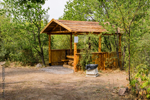 Tremendous An Open Gazebo From A Tree Trunk Benches And A Table Made Ibusinesslaw Wood Chair Design Ideas Ibusinesslaworg