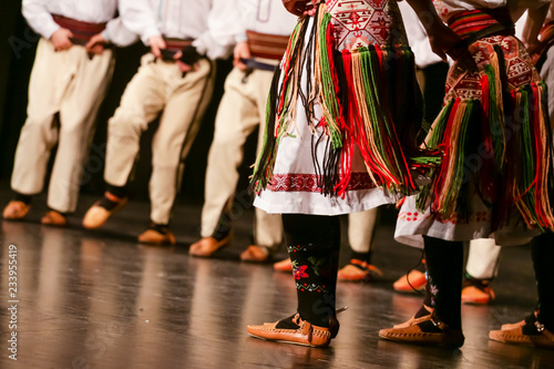 Fotografia  Young Serbian dancers in traditional costume. Folklore of Serbia