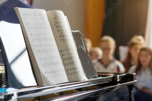 Photo Music notes on piano in a college