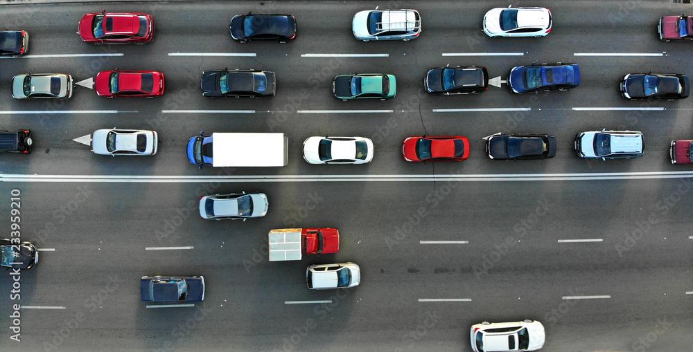 Fototapety, obrazy: City traffic jam on a highway. Aerial.