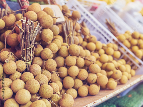 Fruits of Thailand. Exotic litchi in bundles are on the counter of one of the many kiosks located on the streets of Thai cities