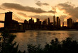 New York cityscape at sunset. New York City, financial district in lower Manhattan view from Brooklyn Bridge Park.