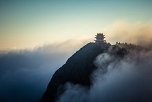 Buddhist Temple Showing Through Fog And Clouds On Mountain Top, Emei Mountain, China