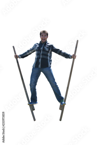 Young man on wooden stilts isolated on white background Fototapeta