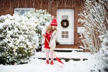 Child Shoveling Winter Snow. Kids Clear Driveway.