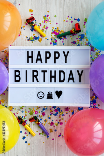 Lightbox with text 'Happy Birthday', decoration party on white wooden surface, top view Canvas Print