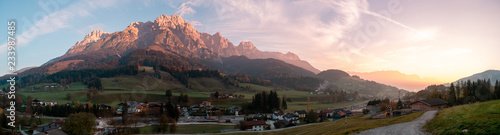 Spoed Foto op Canvas Grijze traf. Panorama image of mountain valley during sunrise in Austria