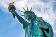 Statue of Liberty against blue sky in New York City