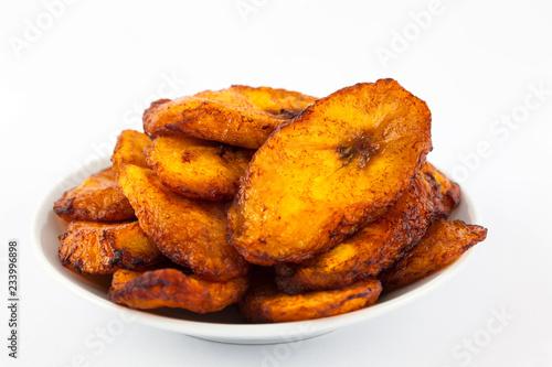 Fototapeta Deep fried ripe plantain slices isolated in white background obraz